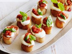 Tomato, Mozzarella and Basil Bruschetta - pulse whole tomatoes, fresh basil, olive oil, and garlic in processor. Top baguette slices with fresh mozzarella and bake to melt then top with tomato mixture to serve.