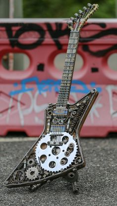 guitar art, metal guitars, heavy metal, welded guitars, lemmy, dimebag, jimmy page, malcolm young, james hetfield, eddie van halen, dave grohl, motorhead, metallica, van halen, led zeppelin, pantera, jimi hendrix Metal Projects, Welding Art Projects, Welding Crafts, Metal Crafts, Guitar Art, Heavy Metal Art, Scrap Metal Art, Welded Metal Art, Metal Tree Wall Art