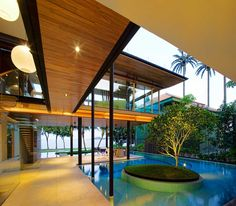 Guz Architects: Fish House, They provide sustainable design. The tree you see in the pool was saved from being demolished in the building of the house and incorporated into the design. What I love about their designs is the livability. It's gorgeous yes and inviting to enjoy.
