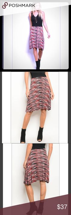 Marcie's Multi-Colored Skirt Marcie's Multi colored skirt is a mix of patterned red, black, and white colors. A-line hem with soft Rayon & Spandex Mix. Black waistband. Trindy Clozet Boutique Skirts