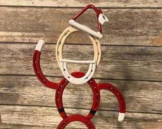 We Specialize in Horseshoe Art and Metal Art! by TudorsCreations Horseshoe Christmas Tree, Western Christmas, Christmas Yard Art, Christmas Holiday, Christmas Ideas, Christmas Crafts, Horseshoe Projects, Horseshoe Crafts, Horseshoe Art