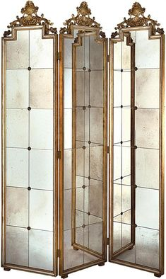 """This lovely room screen features antiqued mirrored panels with gold accents. The screen measures 60""""W X 86""""H. Click on image for greater detail.        This item ships via motor freight. Freight charg"""