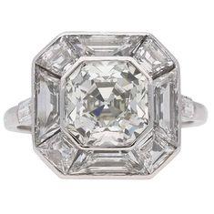 Art Deco Asscher cut diamond cluster ring, English, circa 1930. For Sale