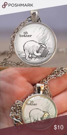 BOTHER POOH NECKLACE Made of glass and alloy.  Medallion is about an inch. The chain length is approximate between 17 to 20 inches.  If you need exact chain length please ask. Please ask questions before purchase. Ty Jewelry Necklaces