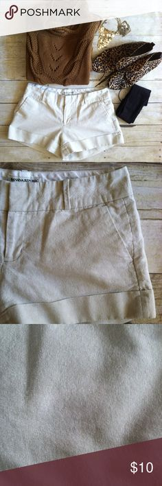 """Banana Republic natural shorts with shimmer Linen blend shorts with cuffed hem. Natural color with silver shimmer. Fully lined. Flat front. Two slant hip pockets. Belt loops. Add tights for a fall look that is right on trend! 54/43/3 linen, cotton, other. 100% poly lining. Lighter area on right side, very hard to see. I tried to show it in pic 3. Other wise great condition. Size 2. 3"""" inseam. 8"""" rise. 14.5"""" waist laying flat. Banana Republic Shorts"""