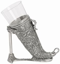 Celtic wine goblet shaped as a cow's horn. This is highly decorated in pewter and glass. Also is capable of being tied around the neck by simply adding a strap to the built in loops.