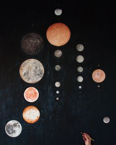 """all the moons of our solar system, to scale, in order of closeness to the sun. watercolor on linen. 52 x 66"""""""