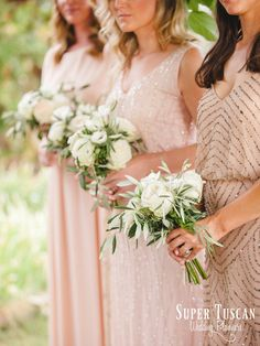 white roses and olive branches for these bridesmaids during a Tuscan wedding in Italy
