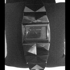 Karl Lagerfeld Watch A black chrome adjustable watch. New with tags and plastic protector still in place. Haven't used it which is why it's up for sale. It makes a great accessory piece as the pyramid lead an optical dimension. No box CHANEL Accessories Watches