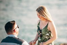 He surprised her on a family trip to Hawaii for a photoshoot proposal on the beach!