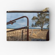 """""""The Tree behind the Gate"""" Zipper Pouch by colinsart Iphone Wallet, Sell Your Art, Gifts For Family, Zipper Pouch, Are You The One, Gate, Cold, Canvas, Metal"""
