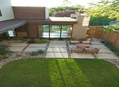 Large Concrete Pavers | Large concrete patio pavers with river rock in between gaps