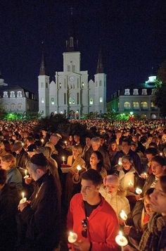 Caroling in Jackson Square holding candles. The Christmas Season can be most enjoyable in New Orleans.