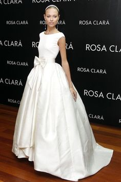 Russian model Dasha Kapustina models several designs for Rosa Clara wedding gowns.