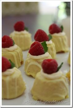 Costco lemon bites with a drop of frosting, mint leaf, and raspberry -- easy tea party food!