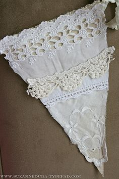 bunting out of vintage linens and doilies