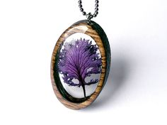 "Chicago-based artist Erin LaRocque (of BuildWithWood) refers to herself as a ""nature jeweler"" who's inspired by Michigan's Hiawatha National Forest. Using foraged materials from this ecological location, the designer encapsulates her found, natural treasures in resin and laser-cut wood frames, before polishing the pieces to give them a brilliant shine. Lush plants, moss, lichen, and …"