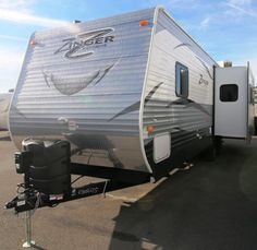 2016 New Crossroads Zinger 30RK Travel Trailer in Arkansas AR.Recreational Vehicle, rv, 2016 Crossroads Zinger30RK, 15,000 BTU Air Conditioner, 5 Function RV Remote, Decor- Kahlua, Electric Awning, Freestanding Table and Chairs, LCD Remote System Fall Promo, Power Tongue Jack, RVIA Seal, Spare Tire & Carrier, Tri-Fold Sofa, Winterization, Zinger Convenience Package,