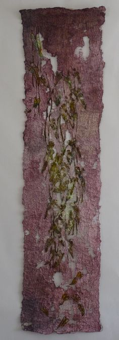 Liz Heywood  Textile artist  creates quilts using a combination of machine embroidery, knitted wire, and paper pulp. Her aim as an artist is to capture the essence of plants and present that essence in a surprising and fresh way.