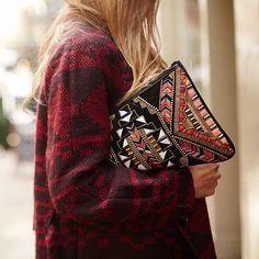 Textured sweater, embellished bag.