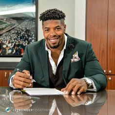 Pen to paper.  #StrongerTogether @ninety1 by miamidolphins