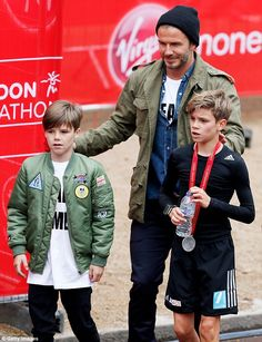 Me and my boys: A beaming David and his youngest son Cruz matched in their army green jack...