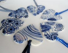 porcelain hearts decorated with traditional dutch delft technique by Harriet Damave i do love blue china!