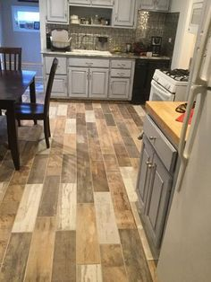 Laminate wood flooring in kitchen- light, medium and dark wood ...