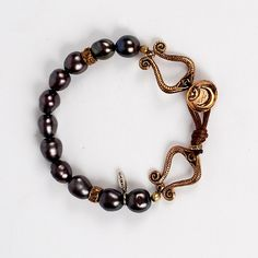 Black pearls symbolize hope. Feel inspired to dream big when you wear this bracelet.  love heals