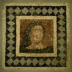 ROMAN POLYCHROME MARBLE AND CALCITE MOSAIC: BUST OF A YOUNG MANWith long hair on a red background within a frame of gray diamond lozenges on black, bordered by white. 2nd-3rd Century AD