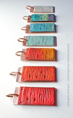 Enameled and riveted pendants by Angela Gerhard - like the texture on these enamel pieces