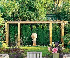 Create a focal point in your backyard with a decorative pergola. This pergola adds depth and dimension to the lushly landscaped yard and provides a framework for one of the owners' favorite sculptures.