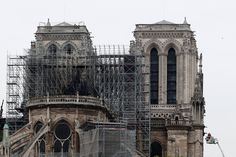 Fueled by a network of ancient wooden beams, the fire moved hungrily across Notre Dame's rooftop toward the cathedral's iconic spire. Lead Roof, Yellow Cloud, Wooden Crosses, Stone Walkway, The Two Towers, Modern Frames, Construction Process, Westminster Abbey, Tower Bridge