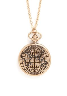 Whirl Traveler Necklace. When you touch down in a new city, you get right down to your itinerary of local marvels in this must-see globe necklace. #gold #modcloth