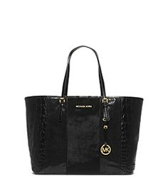 Get a handle on a tried-and-true favorite—our Jet Set tote will stay in your handbag rotation forever. Updated in an opulent blend of hair calf and embossed leather, this sharp carryall is stylish enough to complement your chicest evening looks. Transitioning your look from day to night has never been this easy.