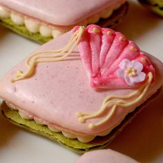 Matcha & sakura flavored macaron shells with sakura white ganache cream