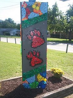 bottle cap mural for our school our outdoor classroom? This idea could also be replaced with children's artwork / tiles (fundraiser ?)