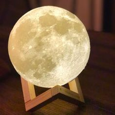 """Promising Review: """"I love my moon lamp! I've only charged it once since getting it and have used it as an ambiance lamp in my bedroom ever since!"""" —Leah Get it from Amazon for $13.99+. Available in three sizes."""