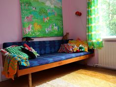 Gorgeous couch with crazy color decor (including the MLP painting)...and kittens!