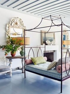 Recast furnishings to give them new life. In the living room, a canopy bed with a tufted cushion inhabits a spot usually reserved for a matching sofa in a traditional seating area. Metal Canopy Bed, Daybed Canopy, Isabel Lopez, Home Design, Interior Design, Cosy Interior, Design Ideas, Interior Stylist, Mediterranean Living Rooms