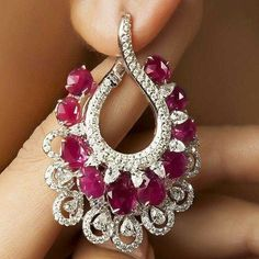 Diamond Necklace Keep your style quotient high as the celebrations continue with these stunning diamond and rubies-studded earrings from Khanna Jewellers. Ruby Jewelry, Ruby Earrings, Pandora Jewelry, Bridal Jewelry, Gemstone Jewelry, Diamond Earrings, Fine Jewelry, Silver Jewelry, Jewellery