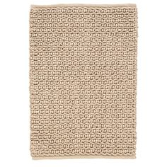 Look closely: the chunky texture and organic look of this rug is just like jute. But it's actually scrubbable, hoseable, easy-to-care-for PET. Durable enough for the outdoors, it will fit right in on porches and patios.