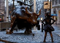 As many American women prepare to draw attention to their role in the workplace, a Wall Street firm on Tuesday put up a statue of a girl in front of Lower Manhattan's well-known bronze charging bull, as if to fearlessly stare it down.