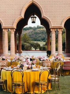 Multicultural wedding reception with yellow tablecloths and pink accents Wedding Color Combinations, Wedding Color Schemes, Wedding Colors, Fresco, Early Spring Wedding, Pink Flower Arrangements, Multicultural Wedding, Wedding Activities, Wedding Linens