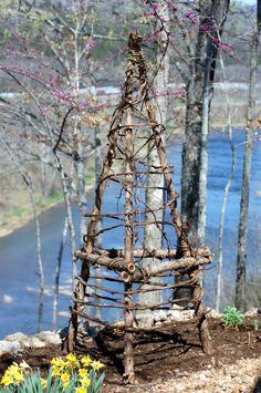 Garden trellis made from cedar limbs and grape & honeysuckle vines
