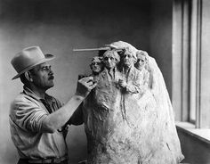 Borglum in his studio with a design for the construction of Mount Rushmore, 1930s.
