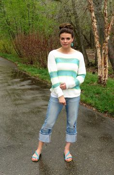 topknot, bright sweater, ripped jeans and bright sandals