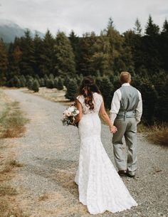 """""""We picked a family property because of the intimate feeling we could create. Mountains in the distance draped in clouds, towering evergreens in every directions with just a short walk down a hill and through the forest to the river. There was even a Christmas Tree farm next door that we were able to use for some of our photos!""""- the bride. 