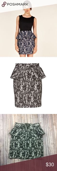 "TopShop Lace Peplum Skirt Top Shop Lace print Peplum skirt black white size 6 Gently Used Condition. No Flaws or stains. See photos.  Length:18""  Waist:14""  Hips:17-18""   All Measurements are Approximate.  Materials:100% polyester  Lining: 100% polyester Topshop Skirts"