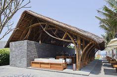 Naman Retreat Beach Bar was completed recently by Vo Trong Nghia Architects. The bar has an area of 143 sqm and is located in Naman resort. Timber Architecture, Tropical Architecture, Vernacular Architecture, Architecture Design, Pool Bar, Bamboo Roof, Bamboo Bar, Bamboo Building, Green Building